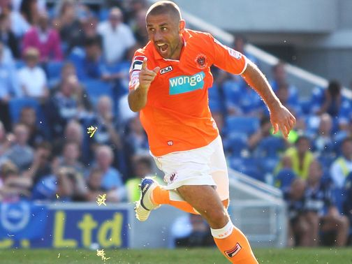 Phillips: Set for another season with Blackpool