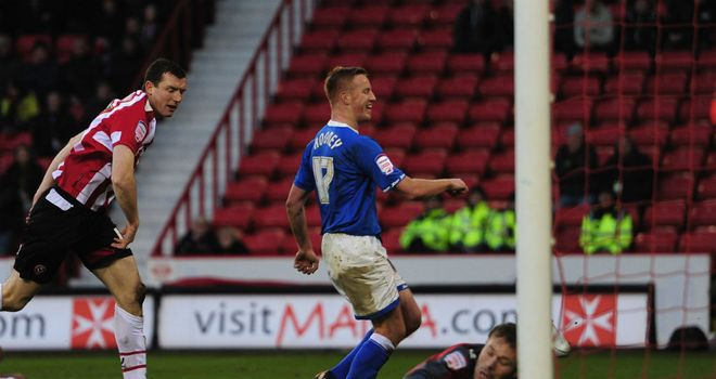 Adam Rooney: The Birmingham striker nets one of his two goals in the 4-0 FA Cup success at Bramall Lane