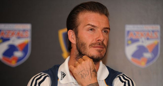 David Beckham: Believes Harry Redknapp would be worthy candidate for England role