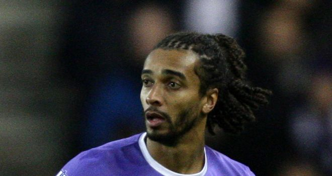 Benoit Assou-Ekotto: Does not believe title is out of reach for Tottenham this season