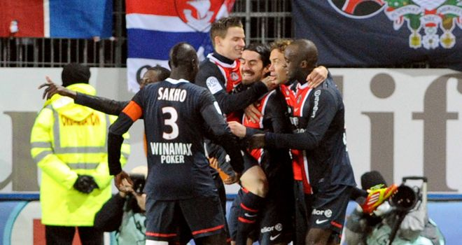 Milan Bisevac is mobbed by his PSG team-mates after scoring against Brest