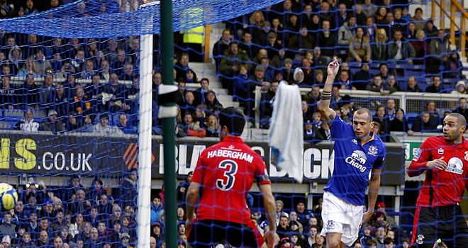 Johnny Heitinga celebrates his early goal for Everton against Tamworth