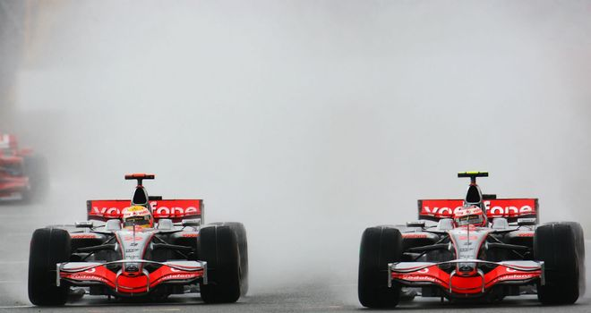 Lewis Hamilton and Heikki Kovalainen battle in the wet in 2008