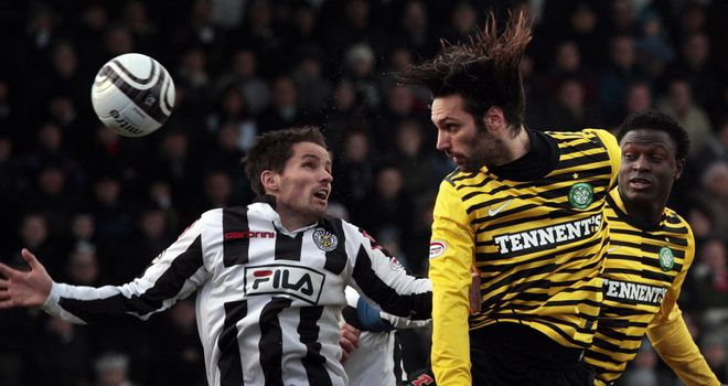 McAusland and Samaras: Battle for the ball at St Mirren Park
