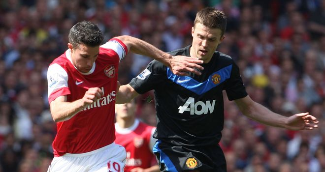 Van Persie and Carrick: will be battling it out at the Emirates
