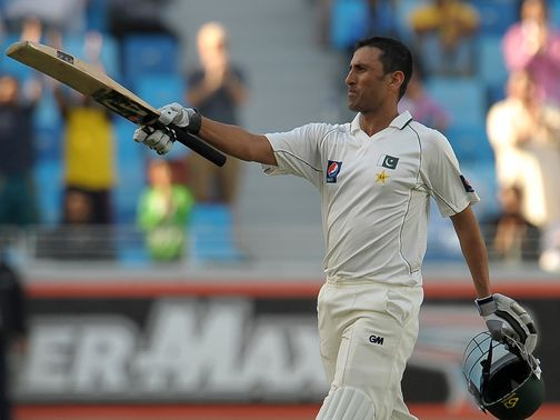 Younus Khan celebrates his century.