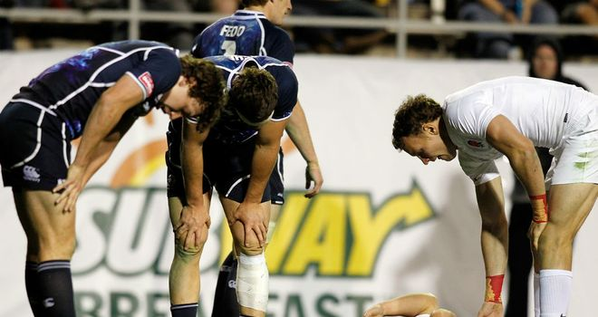 Scotland are left dejected after Christian Lewis-Pratt (on his back) scores the winner