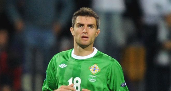 Aaron Hughes: Out of Finland clash with ankle injury