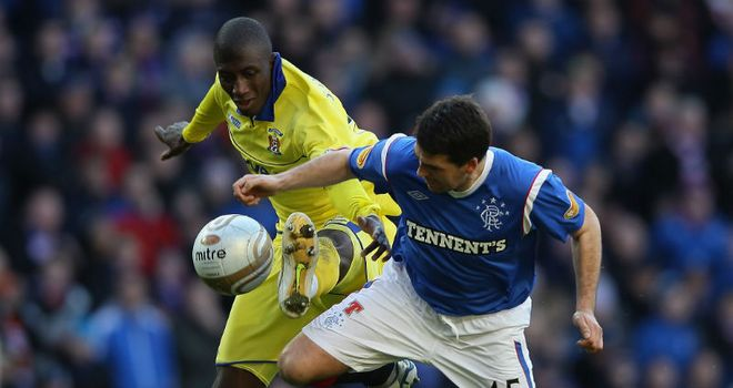 David Healy and Mohamadou Sissoko tussle for the ball during Rangers defeat to Kilmarnock