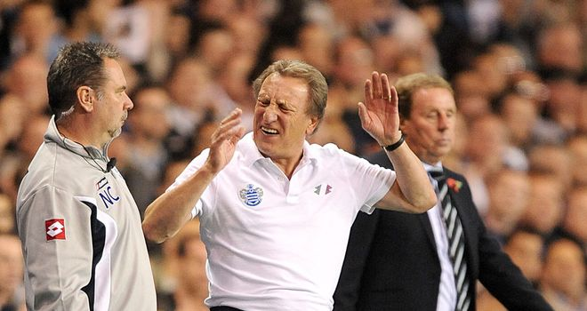 Neil Warnock (centre): Says Harry Redknapp (right) will stay at QPR