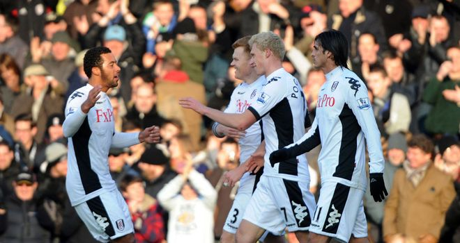 Pavel Pogrebnyak celebrates his first Fulham goal with the opener