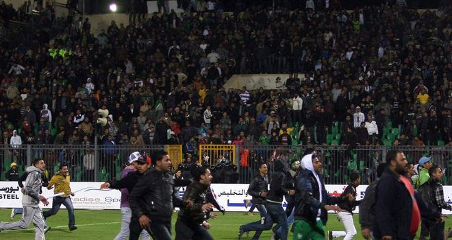 Fans invaded the pitch after the Egyptian league match between Al-Masry and Al-Ahly
