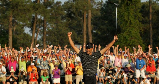 Glorious scenes: Charl Schwartzel proved a popular winner at last year's Masters