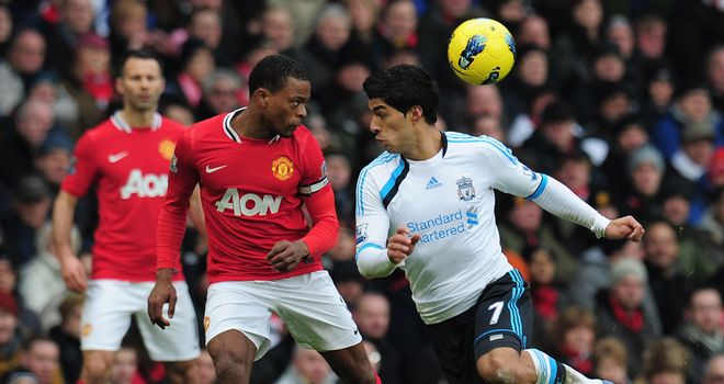Luis Suarez: Refused to shake Patrice Evra's hand before kick-off