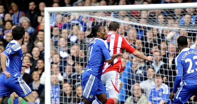 Didier Drogba tussles with Robert Huth during Chelsea's home win
