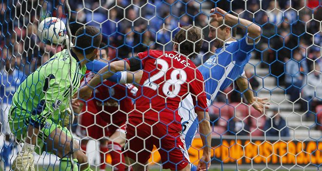 James McArthur pokes the ball home to give Wigan the lead