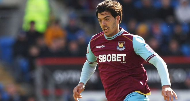 James Tomkins: West Ham defender is expecting a tough encounter against Manchester United