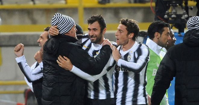 Mirko Vucinic: Celebrates after scoring stunning extra-time goal