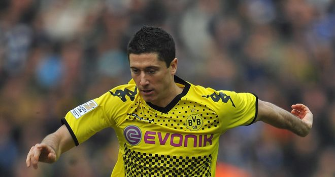 Robert Lewandowski: Scored a goal in each half as Borussia Dortmund won 3-1 at Wolfsburg