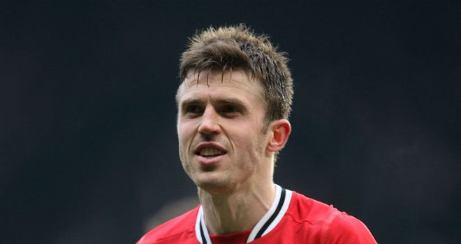 Michael Carrick: Manchester United midfielder says title race will not be over after the derby