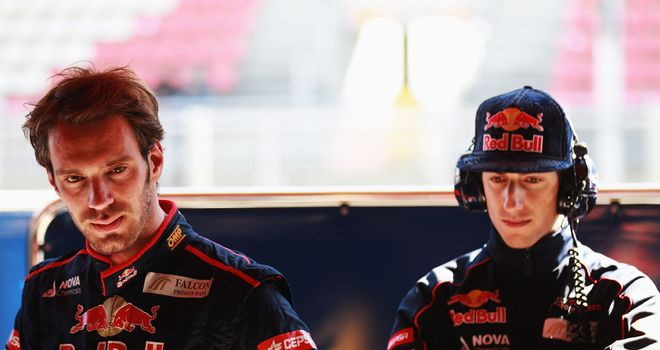 Vergne (L) hands over the STR7 to Ricciardo (R) on Saturday