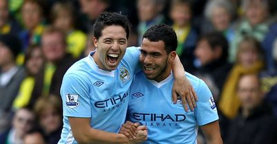 Tevez (r): Celebrates one of his goals against Norwich