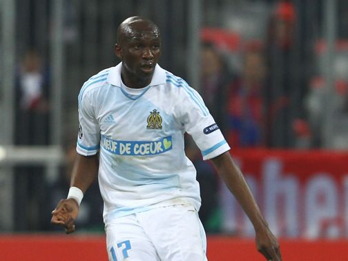 Stephane Mbia: Travelled to link up with QPR