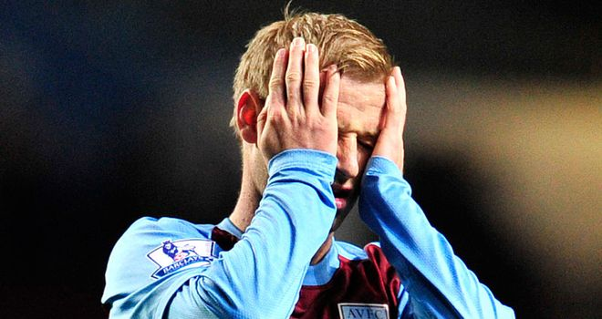 Troubled times: Bannan shows his frustration during Villa's defeat to Bolton