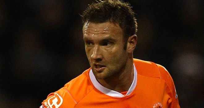 Ian Evatt: Blackpool defender may miss remainder of season after knee surgery
