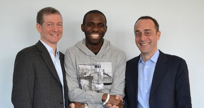 Discharged: Muamba with Dr Andrew Deaner and Dr Sam Mohiddin of Barts Health NHS Trust (Credit: Twitter @OfficialBWFC)