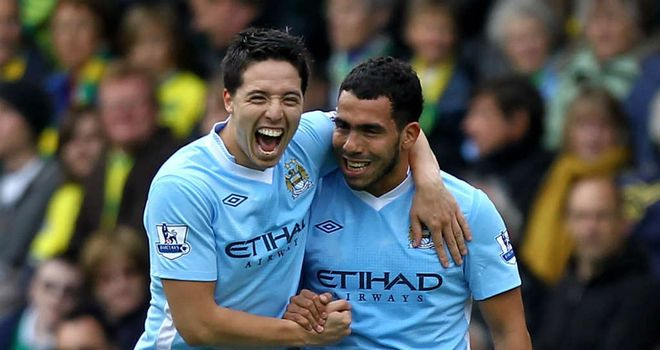 Samir Nasri celebrates with Carlos Tevez after his opening goal.