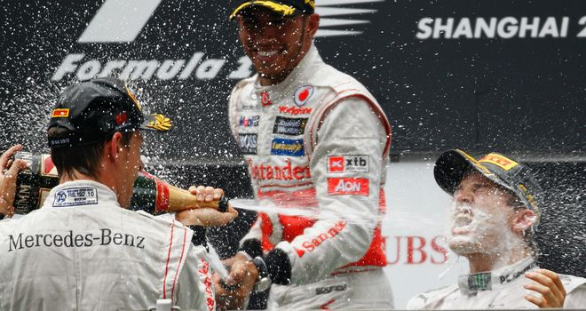 Jenson and Lewis give the race winner a soaking