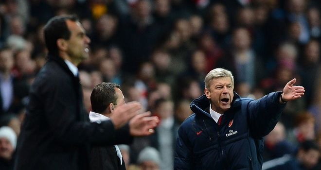 Arsene Wenger is preparing to lock horns with Roberto Martinez