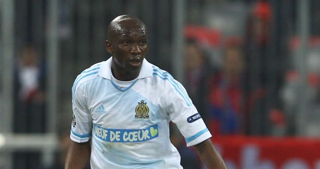 Stephane Mbia: Hoping to win a move to either Manchester United or Chelsea