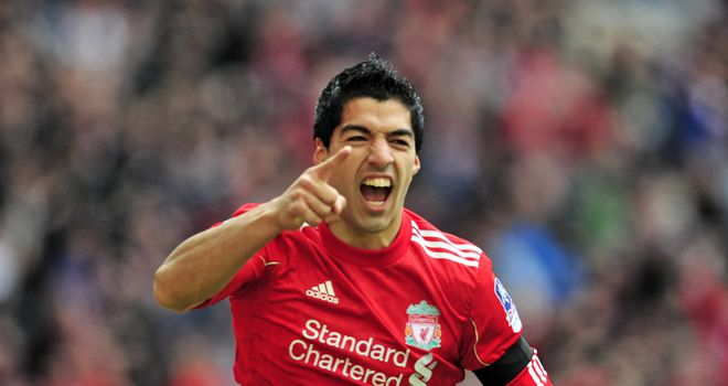 Luis Suarez: Hat-trick hero for Liverpool at Carrow Road