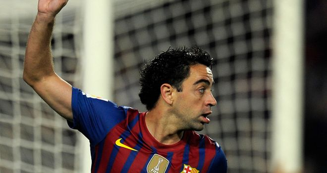 Xavi: The Barcelona midfielder admits he cannot wait to play Chelsea on Tuesday night