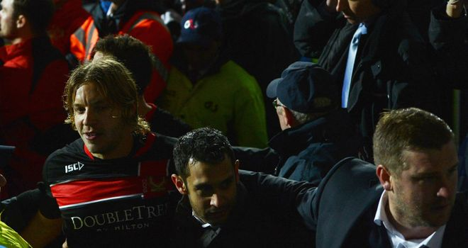 Alan Smith: Is helped from the field by Karl Robinson after being attacked by fans