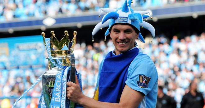 Edin Dzeko: Linked with a move away from Man City but Roberto Mancini hopes he will stay
