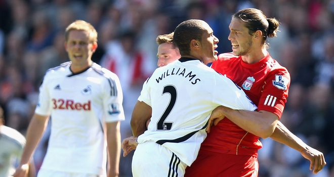Ashley Williams clashes with Andy Carroll