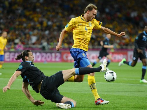 Carroll bids to win the ball from Granqvist.