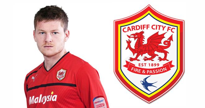 Cardiff's home shirts will be red for next season, with the club's badge also changed