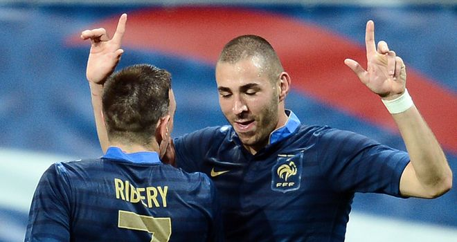 Karim Benzema: France striker celebrates one of his two goals against Estonia