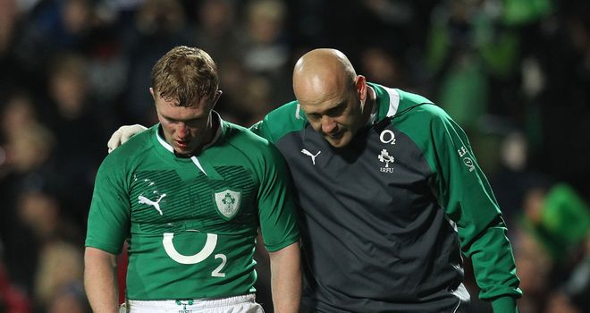 Keith Earls (L) will visit a specialist this week