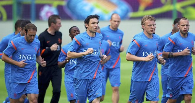 Mark van Bommel says Holland will speak to UEFA about alleged racist abuse