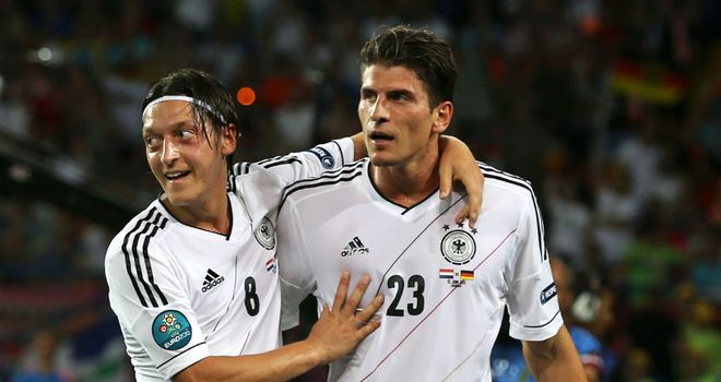 Mario Gomez celebrates scoring against Holland but admits there is a long way to go