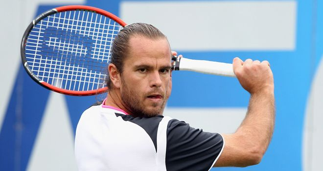 Xavier Malisse: Forced off after four games in his match