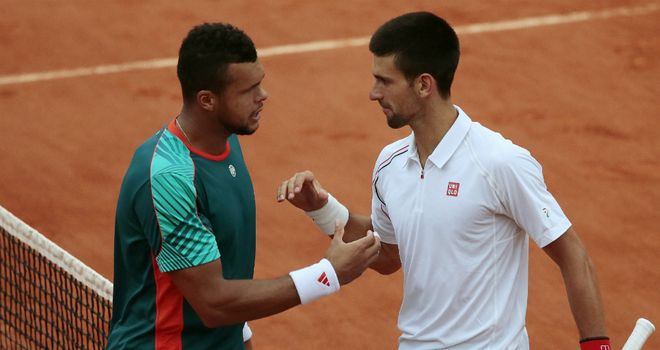 Epic encounter: Jo-Wilfried Tsonga (left) and Novak Djokovic