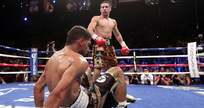 Khan is sent to the canvas during his devastating defeat to Garcia