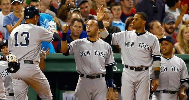 Mark Teixeira is congratulated by his Yankees team-mates after another RBI