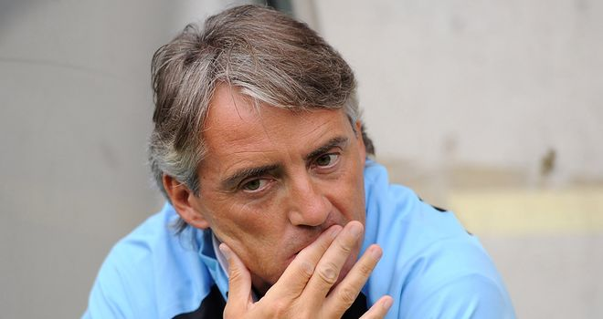 Roberto Mancini: City sat back in the second half to soak up Arsenal's attacks